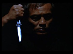 You do not want to face this guy in a dark room, especially when he's got a knife!